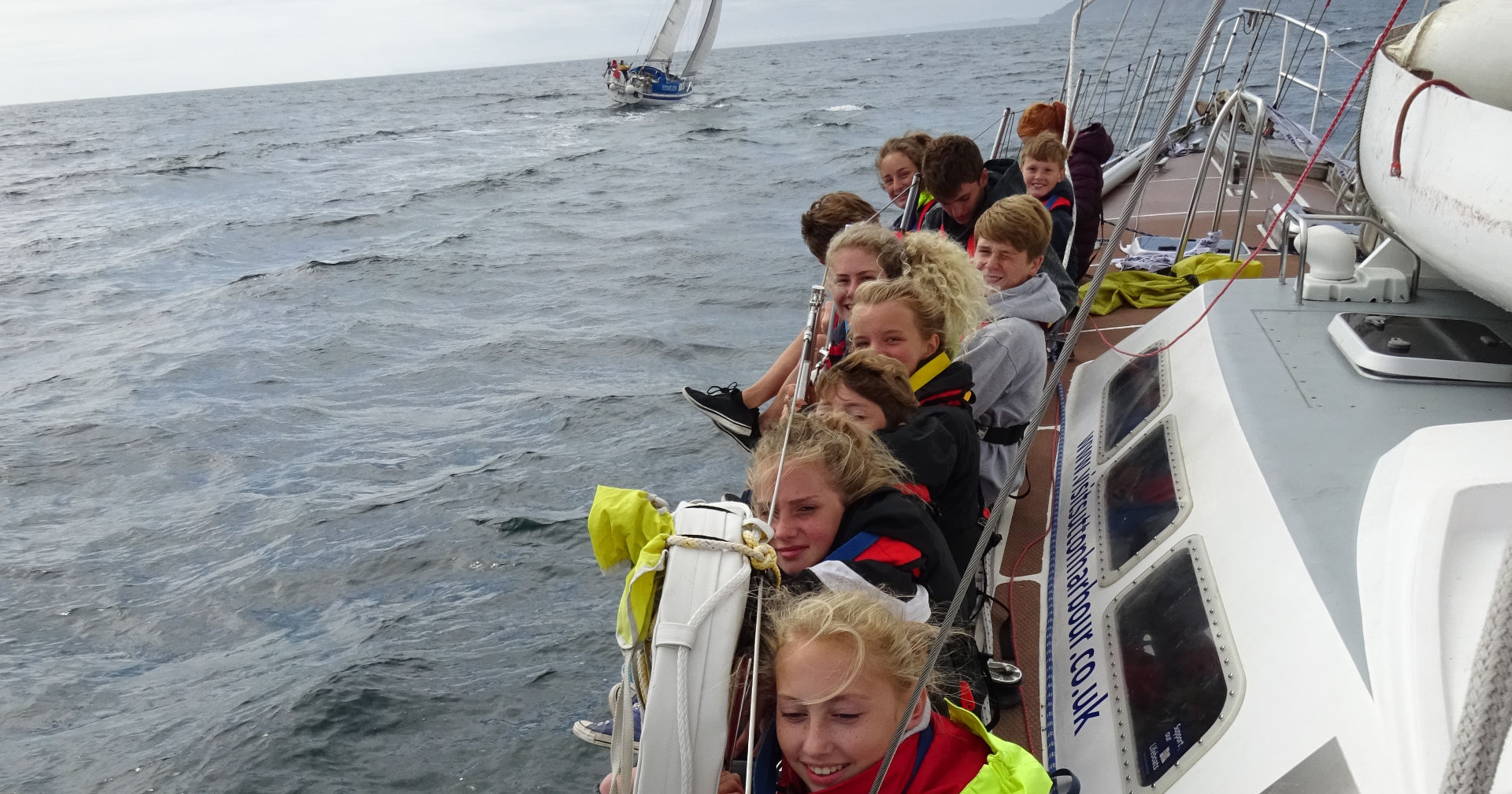 The starting race of the Royal Fowey Regatta, fully funded by POFROC, free voyage for local Fowey young people.