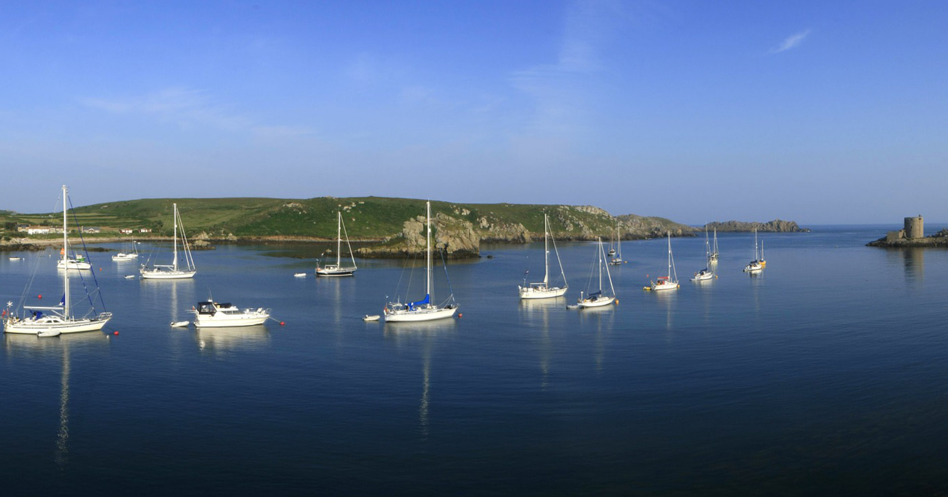 Sail to the Scilly Isles, glittering white sandy beaches and seals playing in the swirling kelp forests.